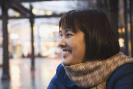 spectating: Asian woman wearing scarf