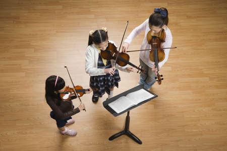 sheet music: Asian girls playing violins