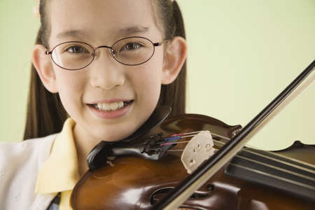 bowing head: Asian girl playing violin