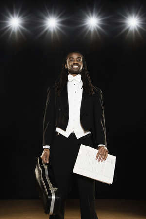 case sheet: African male musician holding case and sheet music LANG_EVOIMAGES