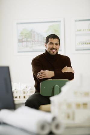 Hispanic male architect sitting in office