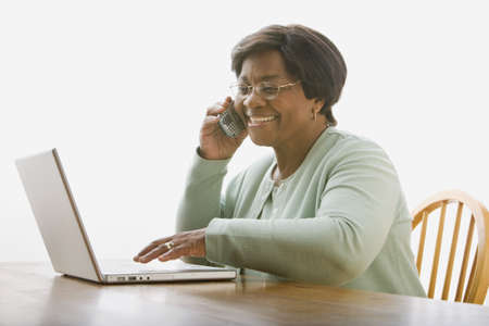 gramma: Senior African woman talking on cell phone LANG_EVOIMAGES