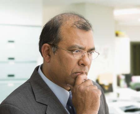 bath gown: Indian businessman thinking