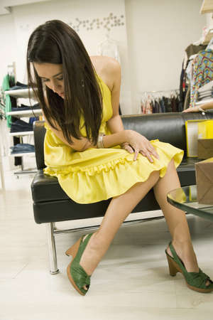 interrogating: Mixed race woman shoe shopping