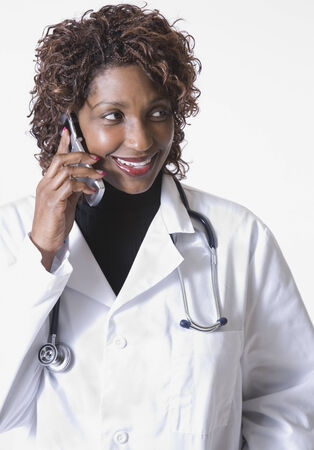 Mixed race doctor talking on cell phone