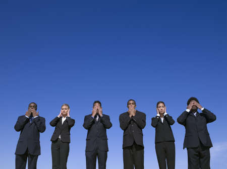 motioning: Business people outdoors motioning hear no evil, see no evil, speak no evil