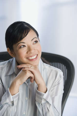 idealistic: Asian woman looking up