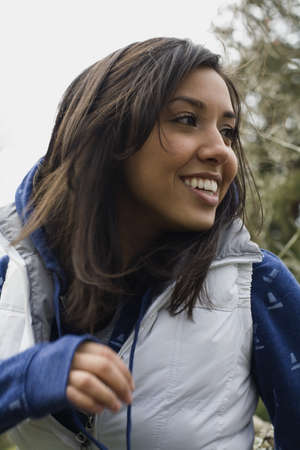 relishing: Middle Eastern woman smiling outdoors