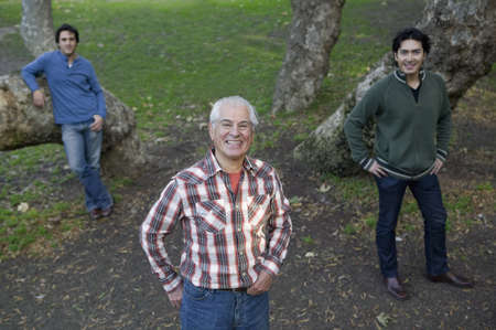 grampa: Hispanic grandfather and grandsons in front of trees
