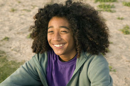 relishing: Mixed Race boy with curly hair