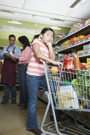 conferring: Asian mother and daughter grocery shopping