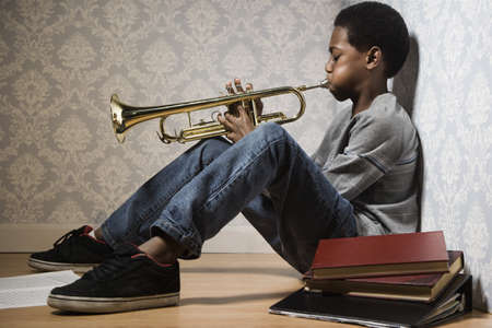 performing: African boy playing trumpet