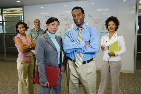 adventuresome: Multi-ethnic business people posing in office
