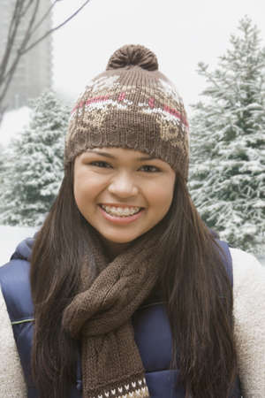 stocking cap: Hispanic girl in stocking cap and scarf outdoors