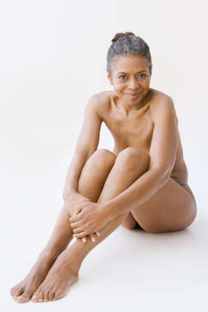 african american nude: Mixed race woman sitting on floor naked