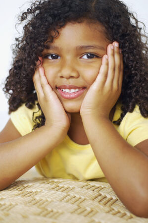 attired: Close up of mixed race girl with head in hands