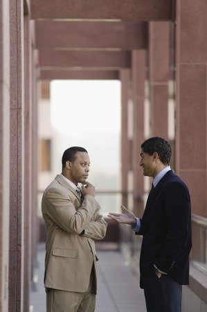 talker: Businessmen talking outside