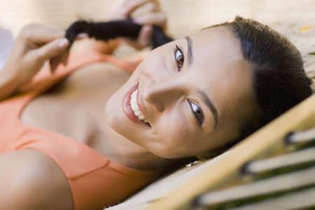 latina america: Hispanic woman laying in hammock LANG_EVOIMAGES