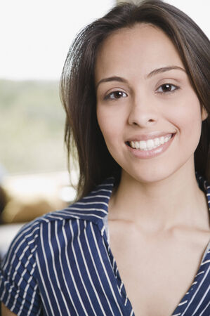 gratifying: Confident Hispanic woman smiling