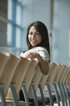 indignant: Hispanic woman waiting in airport