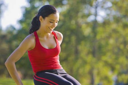latina america: Hispanic woman in sportswear outdoors LANG_EVOIMAGES