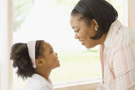 fathering: African mother and daughter looking at one another