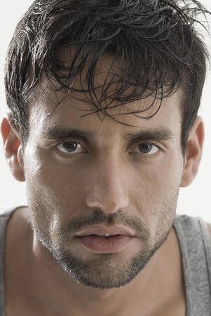 sweating: Serious Hispanic man