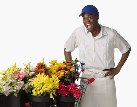 Surprised African florist with cart of flowers