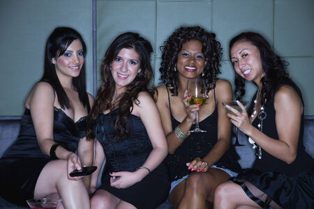after hours: Women drinking cocktails in nightclub