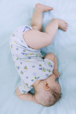 mixed race baby: Mixed race baby sleeping LANG_EVOIMAGES