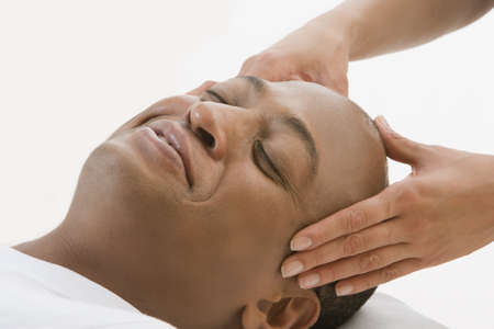 slumbering: African man receiving massage LANG_EVOIMAGES