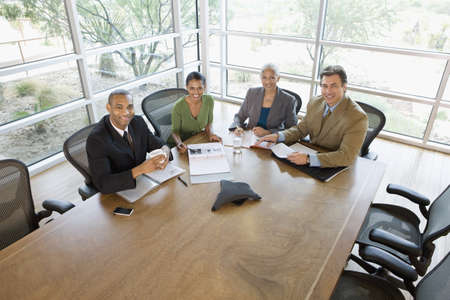 western attire: Businesspeople having meeting in conference room LANG_EVOIMAGES