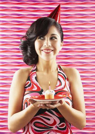devilment: Native American woman holding birthday cupcake