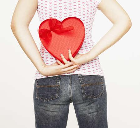 Pacific Islander woman holding heart-shaped box Stock Photo