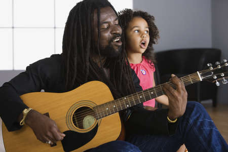 zeal: African father playing guitar, daughter singing
