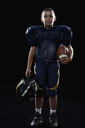 mixed race boy: Mixed race boy in football uniform