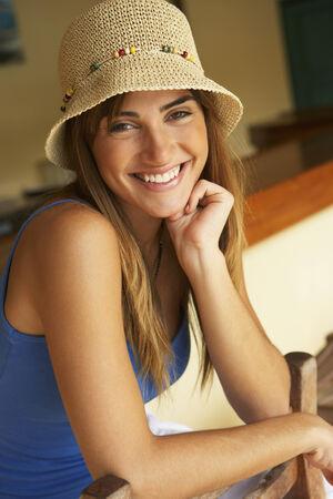 typist: Smiling woman wearing straw hat