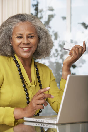 African woman shopping online at home