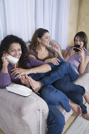 barefoot teens: Multi-generational women using different phones