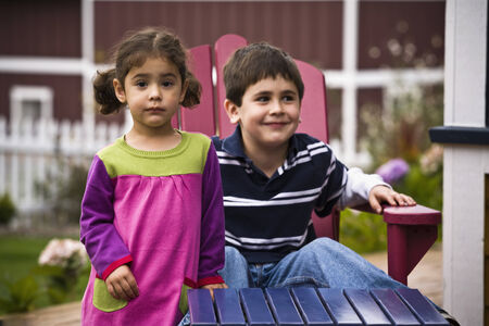 german ethnicity: Brother and sister in backyard