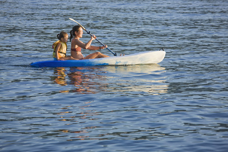 age 40 45 years: Mother and daughter rowing kayak on lake LANG_EVOIMAGES