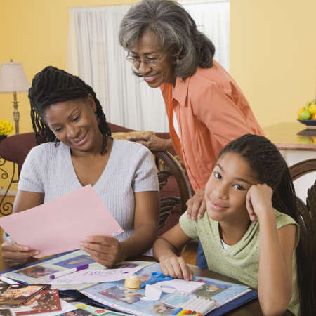 daydream: African family making scrapbook together