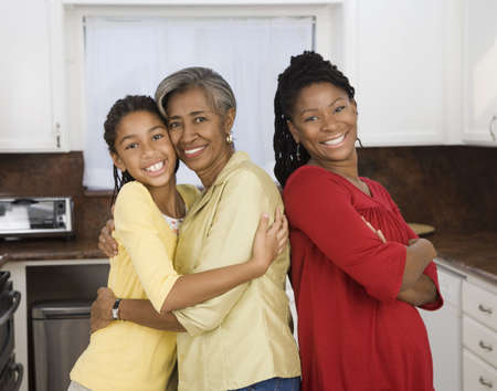 African family smiling in kitchen