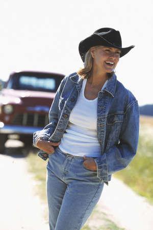 babyboomer: Woman wearing cowboy hat outdoors
