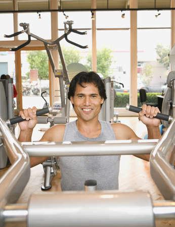 bathtowel: Pacific Islander man exercising in health club