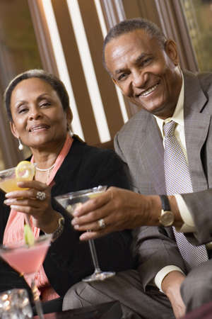 wooing: Senior African couple drinking cocktails