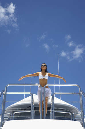 islander: Pacific Islander woman on boat with arms outstretched