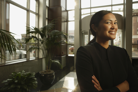 exerting: Portrait of Asian businesswoman with arms crossed