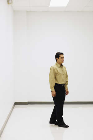 hayman: Philipino businessman in empty room LANG_EVOIMAGES