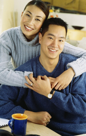 Asian couple hugging Stock Photo